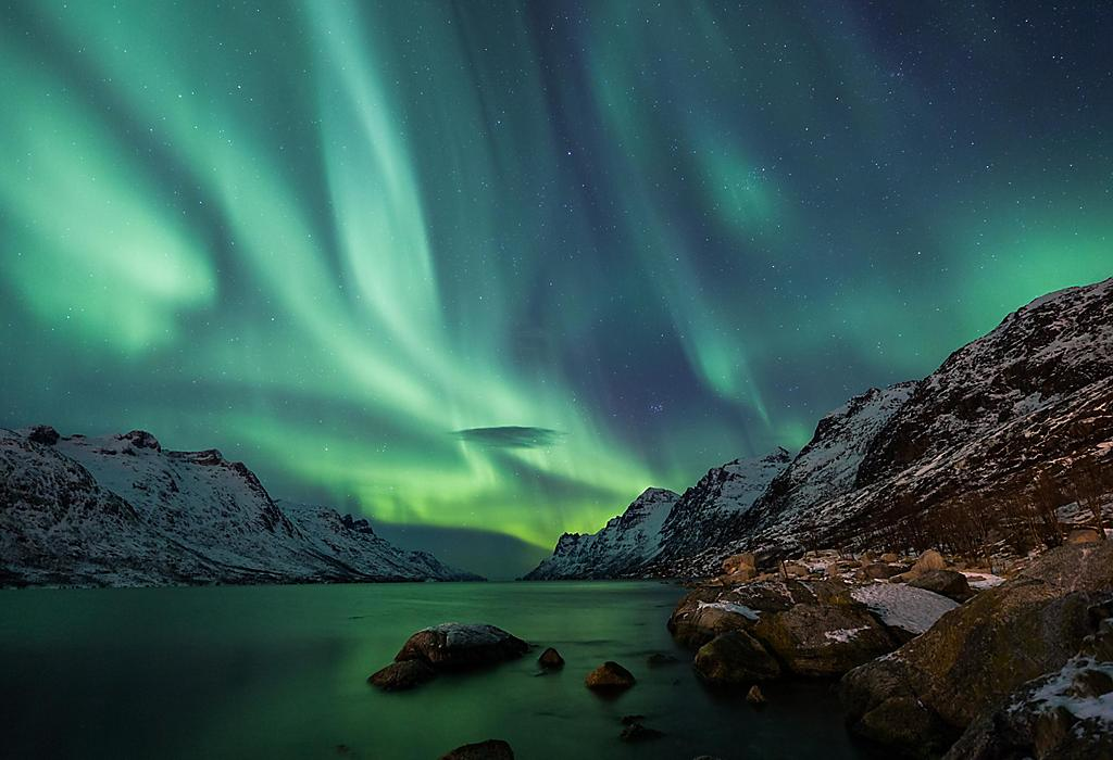Incredible Aurora Borealis activity above the coast in Norway