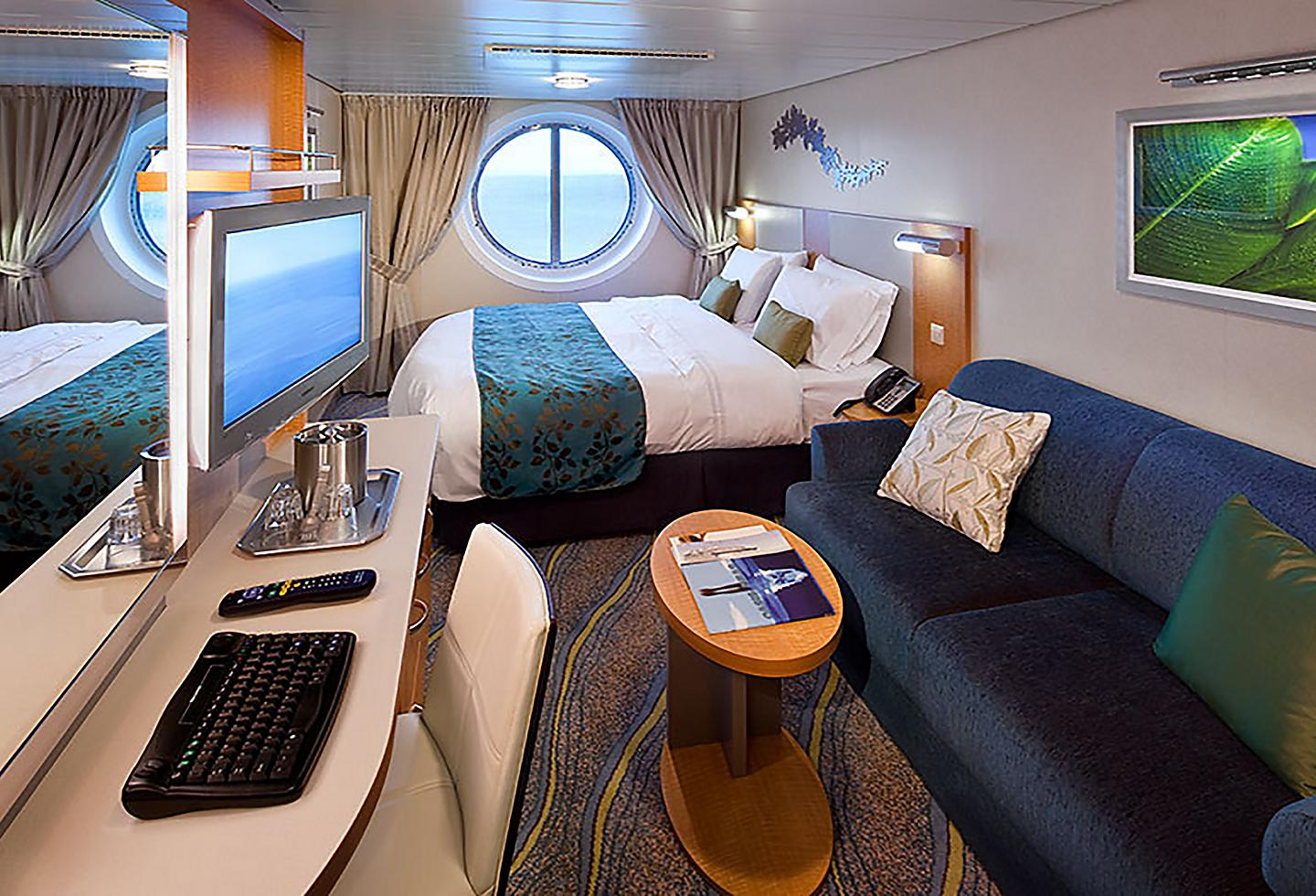 Ocean View Stateroom with a Window and a Sofa