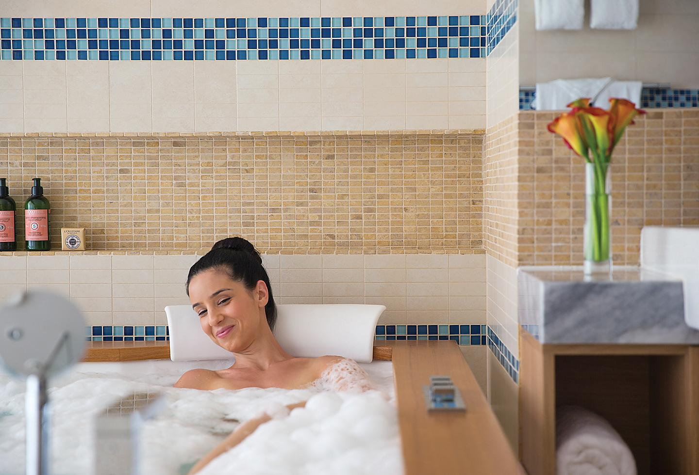 Woman Relaxing and Taking Bubble Bath