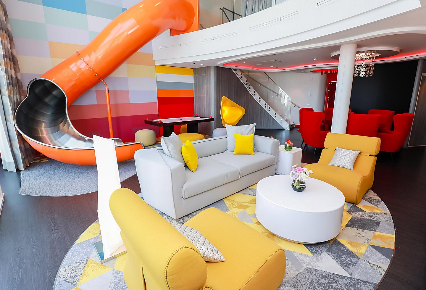 Family Suite Living Room with a Slide and Colorful Furniture.