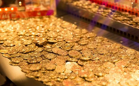 Casino credit golden chips onboard a cruise ship casino.