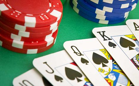 Poker chips and cards on gambling table game onboard a cruise.