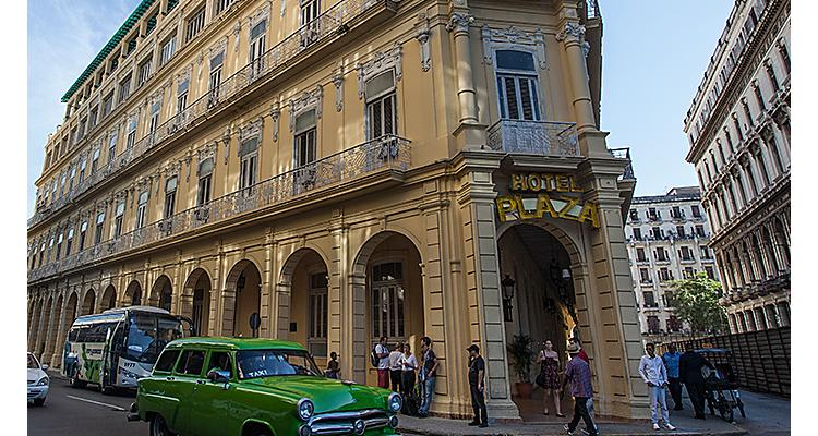 Vintage car driving through the streets of Havana, Cuba on a Cuban Cruise
