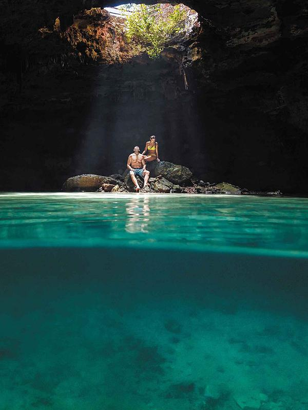 Couple inside of a Cenote in Mexico.