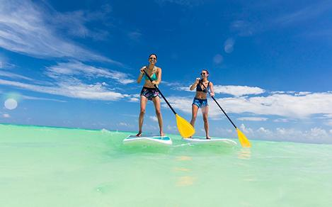 Two women paddleboarding at CocoCay