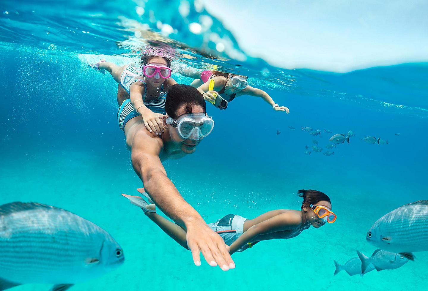 Family Snorkeling in Crystal Clear Waters, Perfect Day Island, Cococay, Bahamas