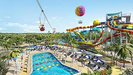 A woman ziplining over the family water features at Perfect Day at CocoCay