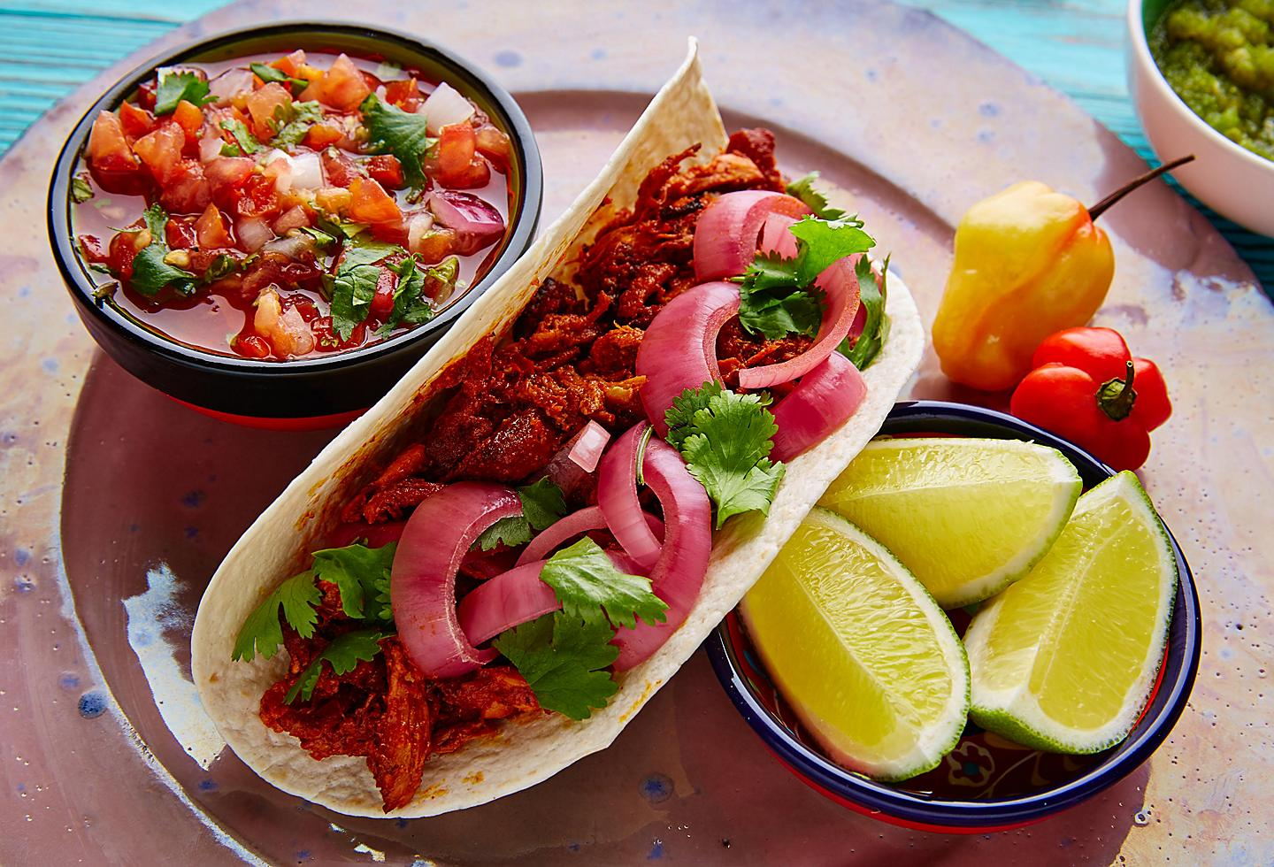 Mexican Conchinita Pibil Taco with Lime and Pico de Gallo