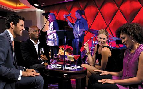 Group of co-workers in a cruise nightclub during a corporate event.