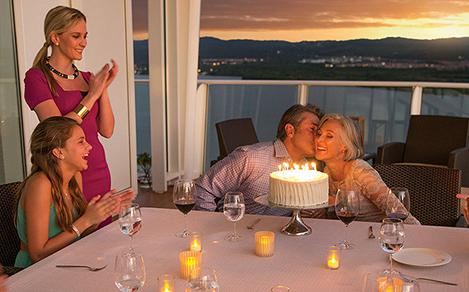 Family celebrating a birthday or special occasion during a vacation on a cruise.