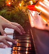 Hands Playing Piano Part of Caroling and Music on Christmas Cruises