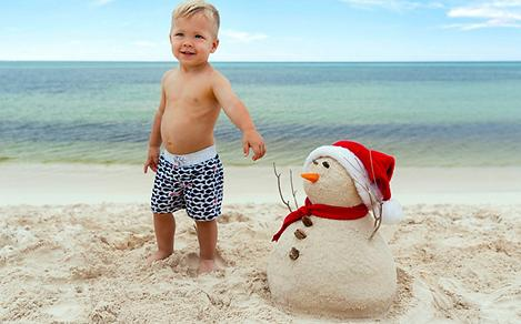 Holidays Mexico Cozumel Boy Building Snowman