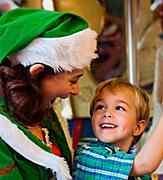 Christmas Elf Riding on the Carousel with a Little Kid