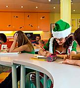 Christmas elves working with a group of kids