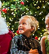Kids with Santa Claus during December Cruise