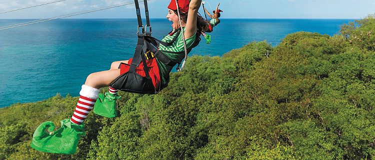 Elf going down on a zip line activity during December cruise