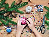 Hands Decorating Christmas Ornaments during Decorating Class onboard Holiday Cruises