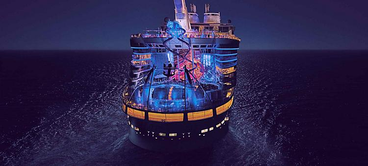Front of a Royal Caribbean cruise ship during nighttime.