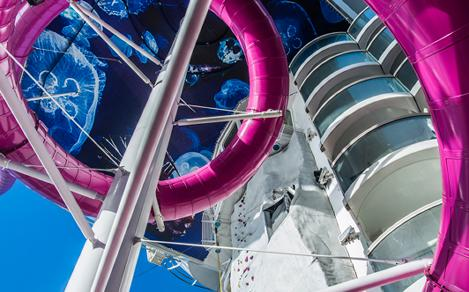 The best and tallest slide at sea is the Ultimate Abyss onboard Royal Caribbean Oasis Class Cruise Ships