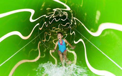 LB, Liberty of the Seas, revite 2016, Perfect Storm green waterslide, slide interior, young girl laughing as she comes down inside slide, family fun, excitement, action