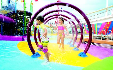 LB, Liberty of the Seas, two kids, children, little boy, girl, playing in Splashaway Bay aqua park, splashing in water, running, fun, smiling,