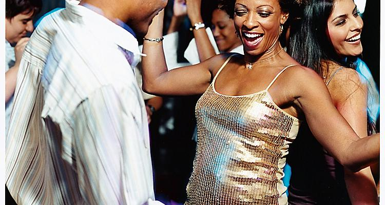 African American or AA Couple (or passengers or two people) dancing in onboard or on board disco or nightclub or dance club or lounge; other people dancing in background, Radiance Class, JW, Jewel of the Seas,fleetwide