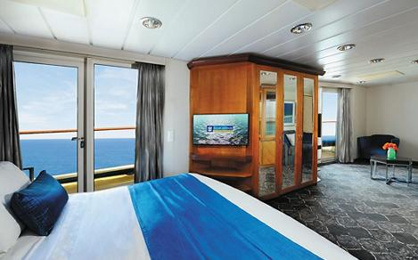NE, Empress of the Seas, Owner''s Suite (Aft version), room 8186, bedroom, bed, bedding, outside view, ocean view, sitting area, living room area in background, flat-screen monitor, wardrobe, shelving, stateroom, cabin, no people