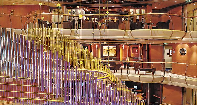 View of onboard or on board sculptural or 3-D art installation in Centrum.  Yellow, pink or lavender or light purple hanging sculpture, Radiance Class, JW, Jewel of the Seas