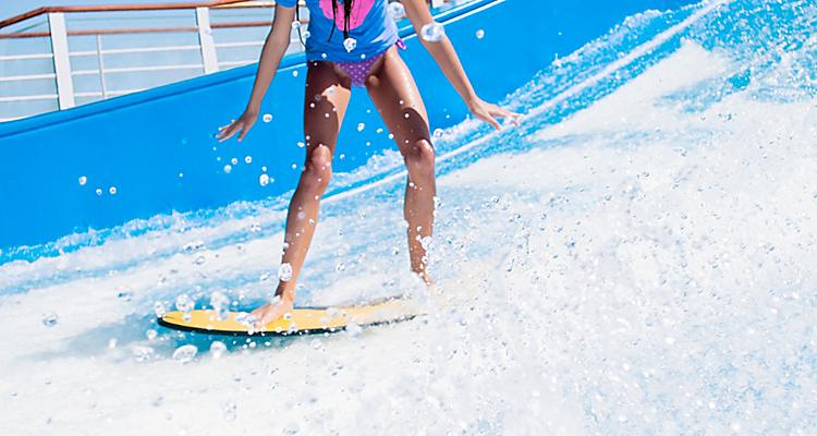 Grab a board and hang ten on the first-ever FlowRider® surf simulator on a Voyager Class ship