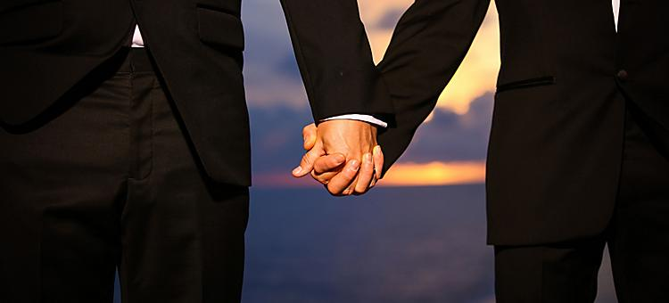 Couple holding hands during a Royal Caribbean cruise wedding.