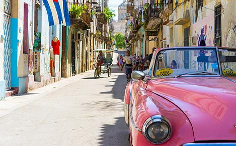 An old pink car in Havana, Cuba