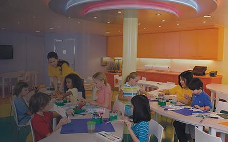 Children creating art at the Adventure Ocean Art activity onboard a Royal Caribbean cruise.
