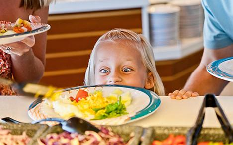 Girl looking at food part of the My Family Time cruise dining experience for kids.