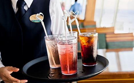 Fountain sodas on serving tray, cruise drink package for kids by Royal Caribbean.