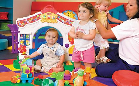 Toddlers in a playroom with the best cruise sitters and nursery services.