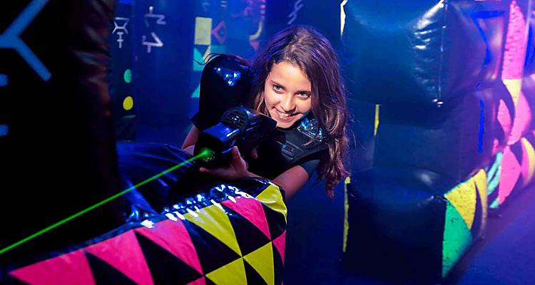 Girl Playing Laser Tag Onboard