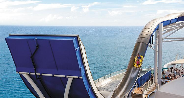 LB, Liberty of the Seas, Tidal Wave slide, guests, woman and child on slide, ocean view in background, fun, excitement