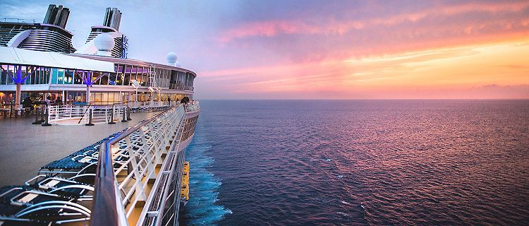 Side photo shot of the deck from Royal Caribbean's Oasis of the Seas cruise ship sailing through the ocean.
