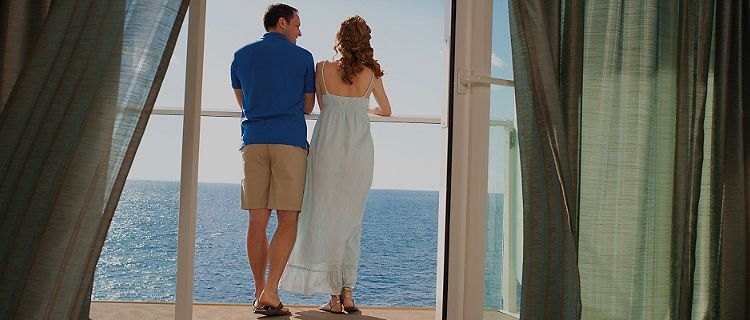 Couple looking at an ocean view in the balcony