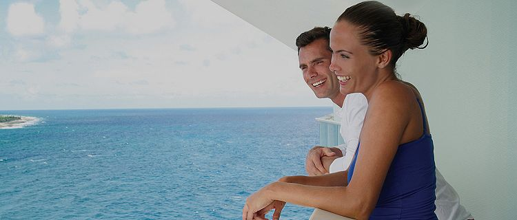 couple on a balcony with ocean view