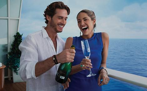 couple onboard enjoying champagne with ocean view
