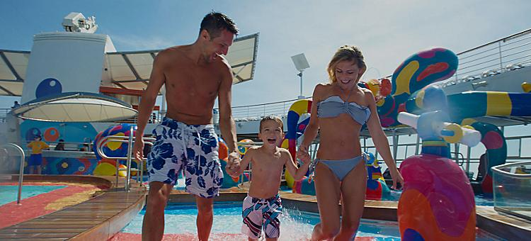 Family of three having an amazing onboard experience in the pool