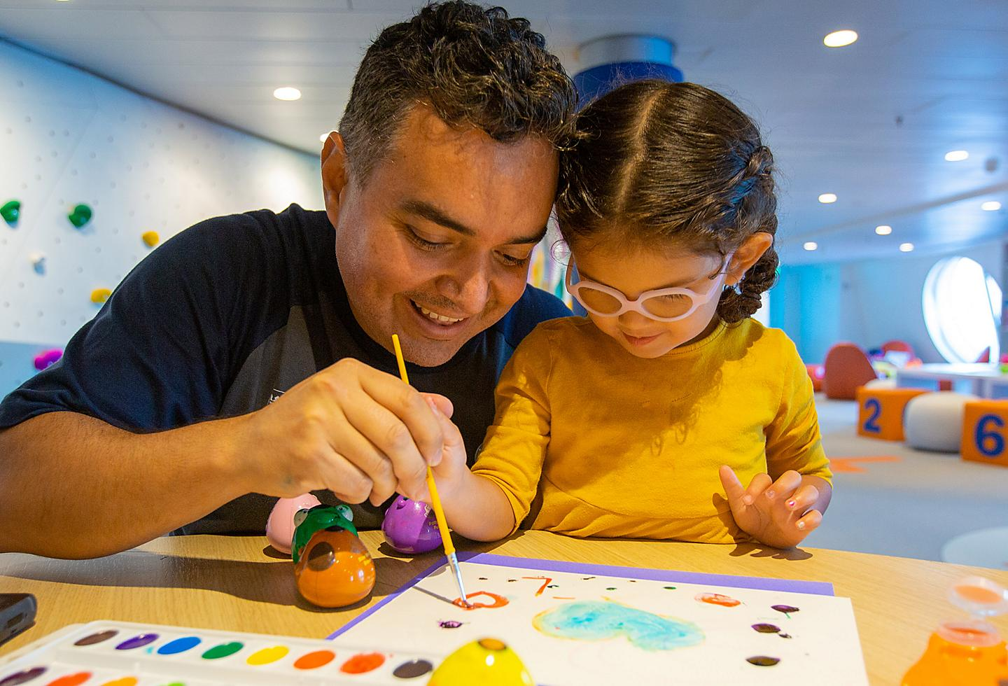 Father and Daughter Using Water Colors at Adventure Ocean