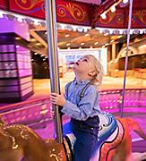 Young Boy Enjoying the Carousel