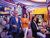 Navigator of the Seas Couples Enjoying Cocktails by the Slots Machine