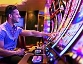 Man Enjoying the Casino Machines on Harmony of the Seas