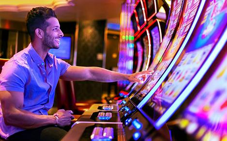 Man Enjoying the Casino Machines on Harmony of the Seas