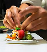 Close-Up of the Sushi Chef Preparing Sushi Roll
