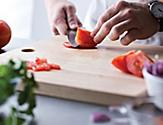 Close-Up of the Chef Cutting Vegetables
