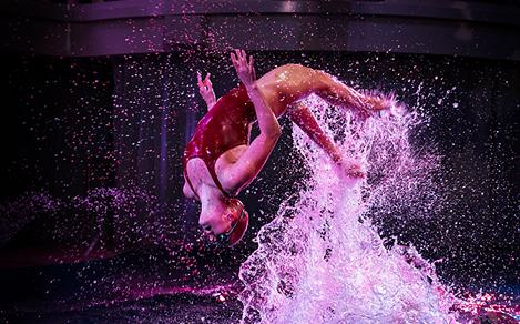 Performer Jumping out of the Pool